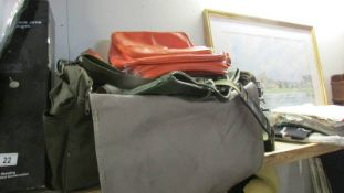 A holdall and other bags.