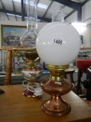 A copper oil lamp with shade and chimney and a pottery electric lamp with hunting scene decoration