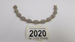 A 9ct gold and diamond bracelet.