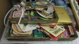A quantity of beer mats, match boxes etc.