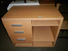 A modern teak-effect home fabricated office unit with drawers and shelves