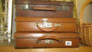 3 vintage suitcases.