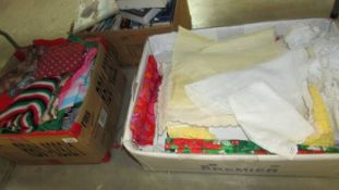 2 boxes of assorted textiles.