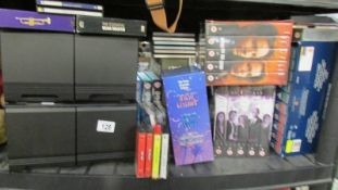 A quantity of DVD's including boxed sets and a quantity of CD's.
