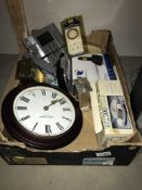 A box of telephones and clocks (4 of each) and a timer