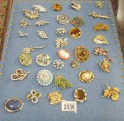 Approximately 35 assorted vintage brooches (display stand not included).