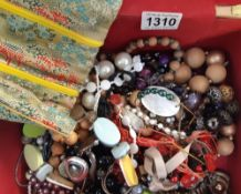 A vanity case with costume jewellery