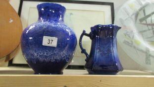A Lancaster pottery vase and a blue pottery jug.