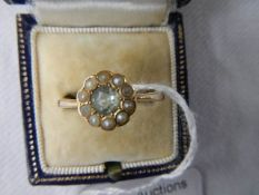 A 9ct gold ring set central stone surrounded by pearls, size T half.