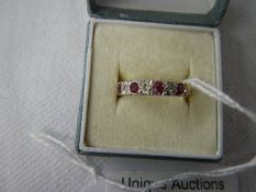 An 18ct gold diamond and ruby set ring, size K.