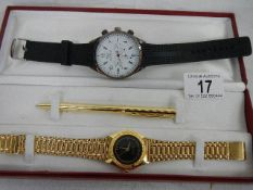 An Emporo Armani wrist watch and a watch and pen set.