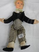 An early 20th century soft toy doll after Norah Wellings, 33 cm.
