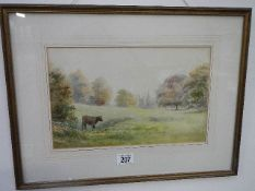 A framed and glazed rural scene watercolour with stately home in the background,