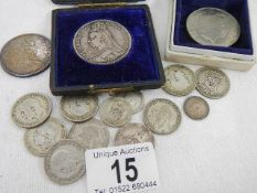A quantity of silver coins and a Queen Elizabeth II £5 coin.