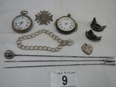 2 silver cased ladies watches, a silver fob, a silver locket on chain and a silver hat pin.