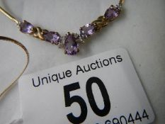A 9ct gold necklace set amethyst. ****Condition report**** Marked 9ct, weight approx.