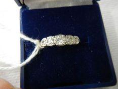 A five stone yellow gold diamond ring, size M.