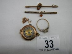A 9ct gold ring size R Half, A gold ladies watch head, a small chain a/f and two brooches.