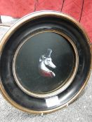 A circular framed painting of a greyhound with a top hat, signed Celia Lake.