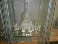 A cut glass decanter and 2 sets of 6 glasses.