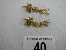 An unusual pair of gold and turquoise earrings. ****Condition report**** No markings.