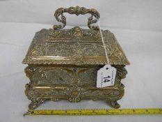 A superb quality decorative casket on shaped legs, 18 cm wide x 14 cm high plus handle,