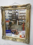 A good gilt framed bevel edged mirror, 65 x 55 cm.