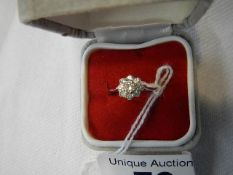 A white gold cluster ring, size I half.
