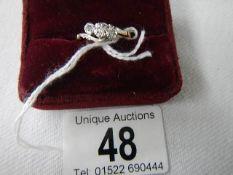 An 18ct gold three stone diamond ring, size O.