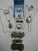 A mixed lot of jewellery including mother of pearl pendant, marcasite brooches,