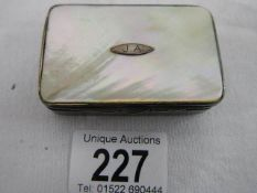 A mother of pearl and silver snuff box, not hall marked.