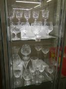 Approximately 26 various cut glass drinking glasses.