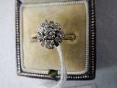 A circa 1960/70's cluster ring set with 6 diamonds, stamped 18ct and platinum, size ).