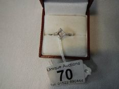 An 18ct gold diamond shaped baguette and brilliant set diamond ring, size M half.