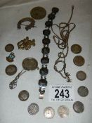 A mixed lot including silver bracelets, silver coins etc., 45 grams.