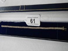 A 9ct gold braclet set approximately 100 small diamonds, in good condition,