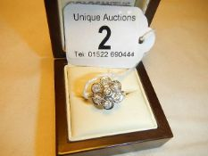 A pretty 9ct white gold diamond cluster ring with central diamond surrounded by six diamonds,