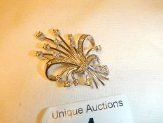 A superb quality white gold and diamond brooch in the form of a spray of flowers.