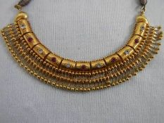 A very ornate 22ct gold (tests as) necklace possibly white sapphire, total weight 31 grams.