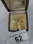 A 9ct gold ring set with large central stone, size S half.