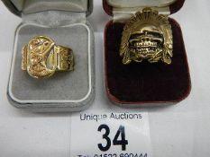 2 unusual brass rings, one depicting an Egyptian Pharoah.