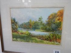 A framed and glazed watercolour river scene, 46 x 38 cm.