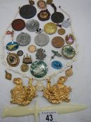 A good lot of interesting items including medallions, letter opener, eagle buckle, coins etc.