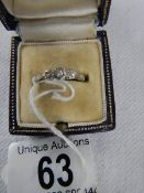 An 18ct gold and platinum ring set 3 small diamonds, size L.