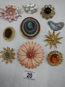 A good lot of ten vintage brooches all in good condition.