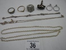 A mixed lot of silver including 3 silver chains, 6 silver rings etc.