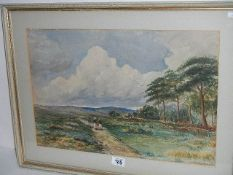 A framed and glazed watercolour rural scene with figures walking up a farm track, signed P Martin,