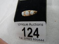 A 9ct 3 stone opal ring (reconstituted opal), weight 3.3 grams, size O half.