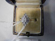 A diamond shaped yellow gold 12 stone diamond ring size L half.