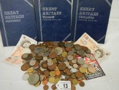 A mixed lot of coins, 2 old £10 notes and 3 empty coin booklets.